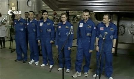 A TV grab, provided by European Space Agency, shows Mars500 experiment crew members, shortly after they left the mock spaceship, in Moscow November 4, 2011. REUTERS/European Space Agency/Handout