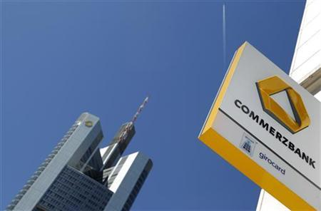 A logo of Germany's Commerzbank is seen in bright sunshine next to the headquarters of the bank in Frankfurt May 25, 2011. REUTERS/Kai Pfaffenbach