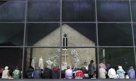 Parishioners and visitors attend mass at a Roman Catholic Church in Ireland in a file photo.   REUTERS/Cathal McNaughton