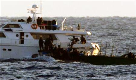 An image released by the Israel Defence Forces (IDF) shows Israeli soldiers boarding one of the two Gaza-bound boats carrying pro-Palestinian activists in the Mediterranean Sea November 4, 2011. REUTERS/Handout/IDF