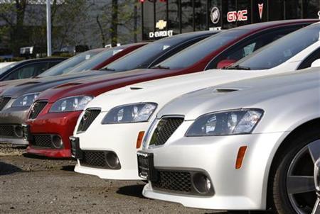 Pontiac G8 sedans sit on a lot for sale at a General Motors auto dealership in Nanuet, New York April 27, 2009.  REUTERS/Mike Segar