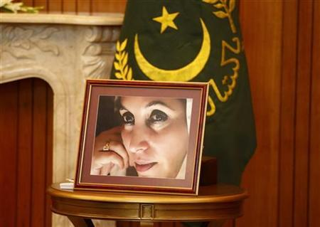 A portrait of assassinated Pakistani prime minister Benazir Bhutto is displayed atop a table during a meeting between U.S. Secretary of State Hillary Clinton and Pakistan's President Asif Ali Zardari in Islamabad October 21, 2011.  REUTERS/Kevin Lamarque