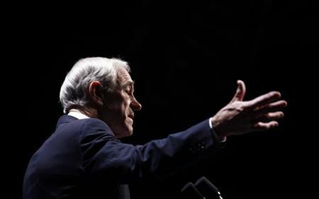 Republican presidential candidate and Congressman Ron Paul speaks at the annual Republican Party of Iowa Ronald Reagan Dinner in Des Moines, Iowa, November 4, 2011. REUTERS/Jim Young