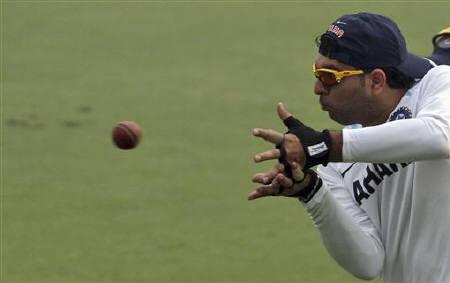 Yuvraj Singh catches the ball during a practice session ahead of their first test cricket match against West Indies in New Delhi November 5, 2011. REUTERS/Stringer