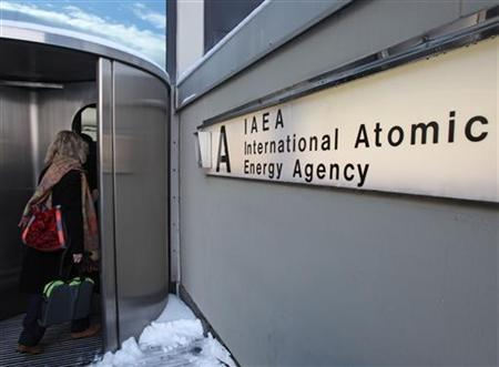 A woman enters the International Atomic Energy Agency (IAEA) headquarters at the UN premises in Vienna, December 2, 2010. REUTERS/Heinz-Peter Bader