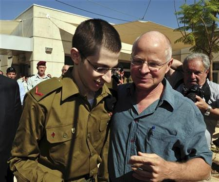 Gilad Shalit (L) stands with his father Noam at Tel Nof air base in central Israel in this handout released by the Israeli Defence Forces (IDF) October 18, 2011.  REUTERS/Ariel Hermoni/IDF/Handout