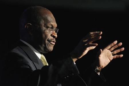 Republican presidential candidate Herman Cain raises his hands as he speaks at a Northern Virginia Technology Council meeting in McLean, Virginia, November 2, 2011. REUTERS/Jonathan Ernst