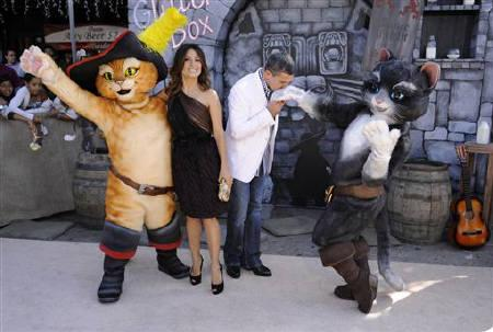 Cast members Antonio Banderas (R) and Salma Hayek pose with characters at the premiere of the animated film ''Puss In Boots'' in Los Angeles October 23, 2011. REUTERS/Phil McCarten/Files