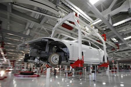The body of a Tesla Model S is transported by an automated crane at the Tesla factory in Fremont, California October 1, 2011. REUTERS/Stephen Lam
