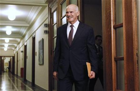 Greece's Prime Minister George Papandreou arrives for a cabinet meeting inside the parliament in Athens November 1, 2011. REUTERS/Yiorgos Karahalis