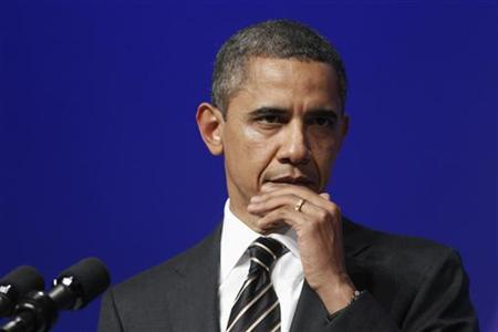 U.S. President Barack Obama listens to a question during a news conference at the end of the G20 Summit in Cannes, France November 4, 2011.   REUTERS/Kevin Lamarque