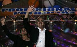 Retired general Otto Perez of the right-wing Patriot Party (R) celebrates with his wife Rosa Leal and supporters after winning the second round of presidential elections in Guatemala City November 6, 2011. REUTERS/Carlos Jasso