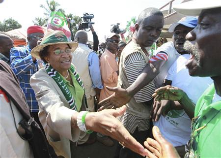 Nobel Peace Prize laureate Ellen Johnson-Sirleaf, who is also Liberia's president and presidential candidate of the Unity Party (UP), greets supporters during a last electoral campaign rally in Monrovia November 6, 2011.     REUTERS/Luc Gnago