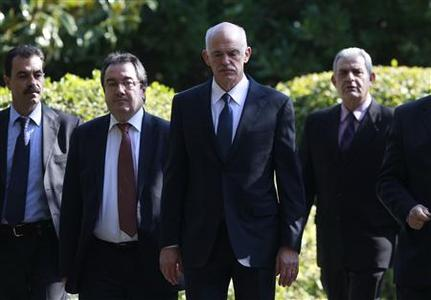 Greek Prime Minister George Papandreou (2nd R) stands outside the Presidential Palace after his meeting with Greek President Karolos Papoulias in Athens November 5, 2011.   REUTERS/John Kolesidis