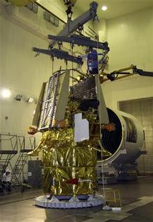 Employees work on the Phobos-Grunt (Phobos-Soil) spacecraft, which has been constructed to retrieve the first ever soil samples from the surface of Phobos, one of the moons of Mars, in Baikonur October 31, 2011.   REUTERS/Oleg Urusov