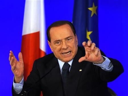 Italy's Prime Minister Silvio Berlusconi gestures during a news conference at the end of the G20 Summit in Cannes, November 4, 2011. REUTERS/Dylan Martinez