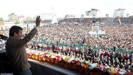Iranian President Mahmoud Ahmadinejad waves to a crowd before speaking in Rasht, 323 km (200 miles) northwest of Tehran January 23, 2011. REUTERS/President.ir/Handout