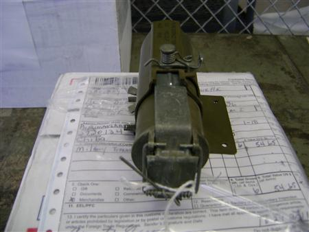 A Vietnam War-era device, identified as an M49A1 phosphorous trip flare, which was found by Federal agents at Chicago's O'Hare Airport, November 7, 2011. REUTERS/U.S. Customs and Border Protection/Handout