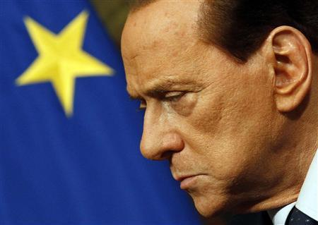 Italian Prime Minister Silvio Berlusconi attends a meeting with European Commission President Jose Manuel Barroso at Chigi palace in Rome in this March 14, 2011 file photo.    REUTERS/Alessandro Bianchi (