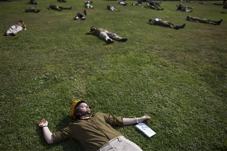 Israeli soldiers role-playing as mock victims lie on the ground during a drill simulating a missile attack in Holon, near Tel Aviv, November 3, 2011. REUTERS/Nir Elias