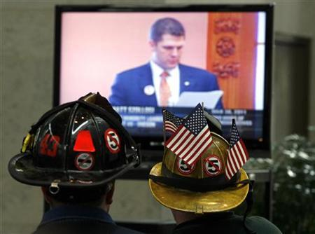 Union supporters watch a broadcast of the Ohio House debate on Senate Bill 5 at the Ohio Statehouse in Columbus, Ohio, March 30, 2011. REUTERS/Matt Sullivan