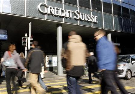People cross a street in front of a branch office of Swiss bank Credit Suisse in Basel November 1, 2011. REUTERS/Arnd Wiegmann