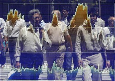 People are reflected on a stock quotation board outside a brokerage in Tokyo, August 11, 2010. REUTERS/Toru Hanai