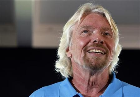 Virgin Group head Sir Richard Branson announces plans to launch a solo piloted submarine to the deepest points of the world's five oceans at a news conference in Newport Beach, California April 5, 2011. REUTERS/Alex Gallardo