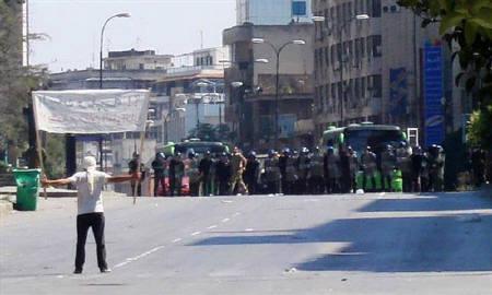 A protester faces riot police at Khalidia, near Homs November 4, 2011. REUTERS/Handout