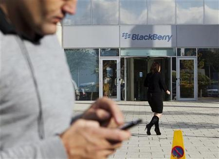 A woman walks outside Research in Motion's (RIM) headquarters in Slough, southern England in this October 13, 2011 file photo.  REUTERS/Olivia Harris