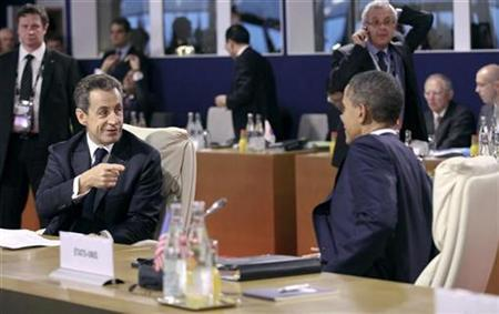 France's President Nicolas Sarkozy gestures towards President Obama during the G20 Summit of major world economies in Cannes, November 3, 2011. REUTERS/Chris Ratcliffe/Pool