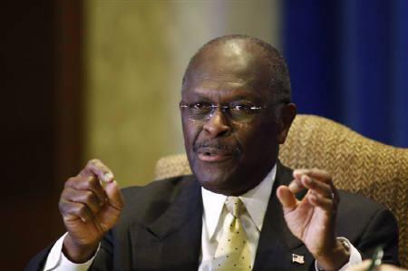 Republican presidential candidate Herman Cain gestures during a debate with Newt Gingrich in Houston November 5, 2011. REUTERS/Donna W. Carson