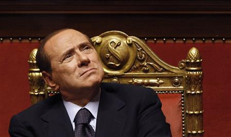 Italian Prime Minister Silvio Berlusconi looks up during a debate at the Senate in Rome, in this June 21, 2011 file photo.    REUTERS/Max Rossi/Files