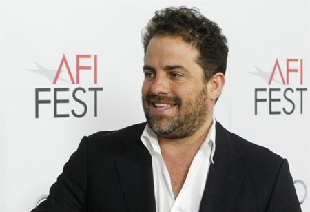 Director Brett Ratner smiles in this picture taken November 3, 2011 at the J. Edgar premiere in Hollywood. Ratner submitted his resignation as a producer of the 84th annual Academy Awards to officials at the Academy of Motion Picture Arts & Sciences November 8, 2011.  REUTERS/Fred Prouser