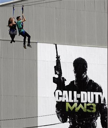 Fans use a zip line during the premiere of the video game ''Call of Duty: Modern Warfare 3'' in Los Angeles, California September 2, 2011. REUTERS/Gene Blevins