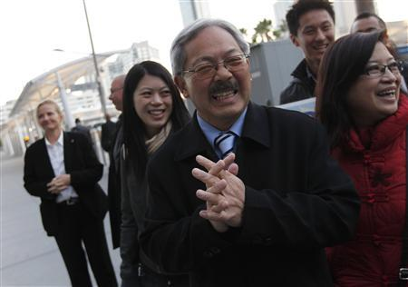 San Francisco Mayor Ed Lee greets commuters with his wife, Anita (R) and daughter Tania, on election day in San Francisco, California November 8, 2011. Lee is seeking election for a first full term in office. REUTERS/Robert Galbraith