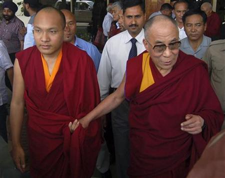 Karmapa Lama (L) and Tibet's exiled Buddhist spiritual leader the Dalai Lama arrive at the Kangra airport on the outskirts of the northern Indian hilltown of Dharamsala May 16, 2011. REUTERS/Stringer
