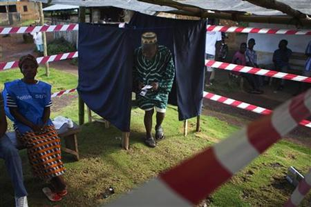 A Liberian man exits a polling booth during presidential elections at Klay town just outside the capital Monrovia November 8, 2011.  REUTERS/Finbarr O'Reilly