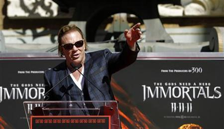 Actor Mickey Rourke speaks at his hand and footprint ceremony at the Grauman's Chinese Theatre in Hollywood, California October 31, 2011.    REUTERS/Mario Anzuoni