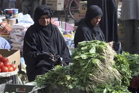 Widows sell vegetables at a market in the central city of Kerbala, 80 km (50 miles) southwest of Baghdad, November 5, 2011.  REUTERS/Mushtaq Muhammed