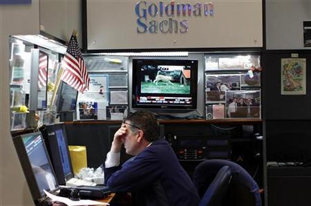 A trader works in the Goldman Sachs booth on the main trading floor of the New York Stock Exchange July 29, 2011.   REUTERS/Mike Segar
