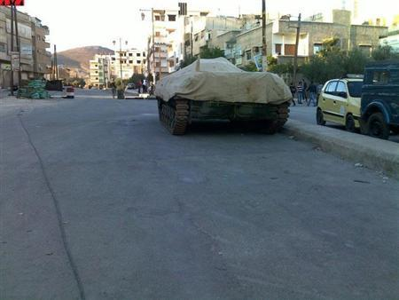 An armoured vehicle is seen in the main square of Al Kiswah, near Damascus, November 6, 2011. Picture taken Novemer 6, 2011. REUTERS/Handout