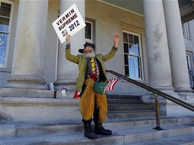 Democratic presidential candidate Vermin Supreme stands on the steps of the statehouse in Concord, New Hampshire, October 28, 2011.  REUTERS/Brian Snyder