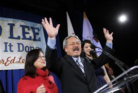 San Francisco Mayor Ed Lee reacts as his wife, Anita, looks on during his election day party in San Francisco, California November 8, 2011. REUTERS/Robert Galbraith