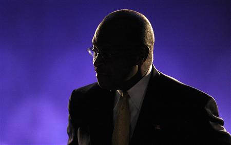 Republican presidential candidate, businessman Herman Cain, listens to moderators at the end of the CNBC Republican presidential debate in Rochester, Michigan, November 9, 2011. REUTERS/Mark Blinch