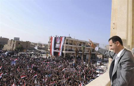 Syria's President Bashar al-Assad greets the crowd during his visit to Raqqa city in Eastern Syria, November 6, 2011, in this handout photograph released by Syria's national news agency SANA. REUTERS/SANA/Handout