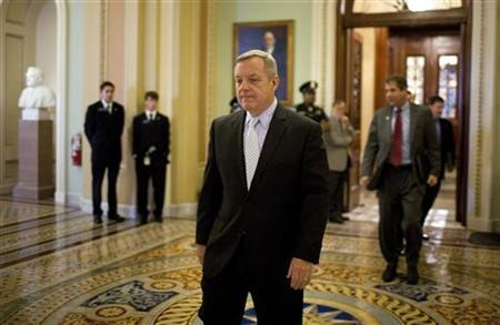 Senator Richard Durbin (D-IL) walks to a caucus meeting with Senate Democrats on Capitol Hill in Washington August 1, 2011. REUTERS/Joshua Roberts