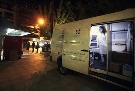 A Greek nurse is seen inside a mobile HIV testing van in Koliatsou square in Athens October 31, 2011. T  REUTERS/Yannis Behrakis