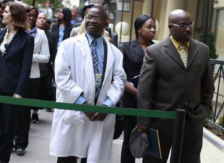 People wait in line to enter a job fair in New York October 24, 2011. New U.S. claims for unemployment benefits fell last week to their lowest since early April and the trade deficit unexpectedly shrank in September, pointing to a slight improvement in the economy. REUTERS/Shannon Stapleton/Files