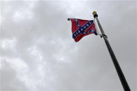 A Confederate flag waves over the grounds of the South Carolina state capitol in Columbia January 9, 2008.  REUTERS/Jonathan Ernst